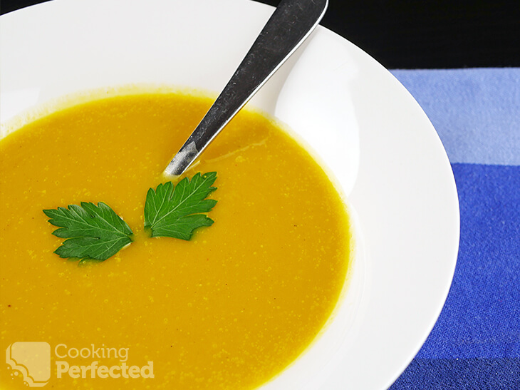 Paleo-Friendly Pumpkin Soup topped with Parsley