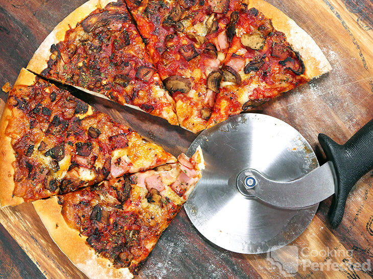 Air Fryer Frozen pizza cut and served into equal portions