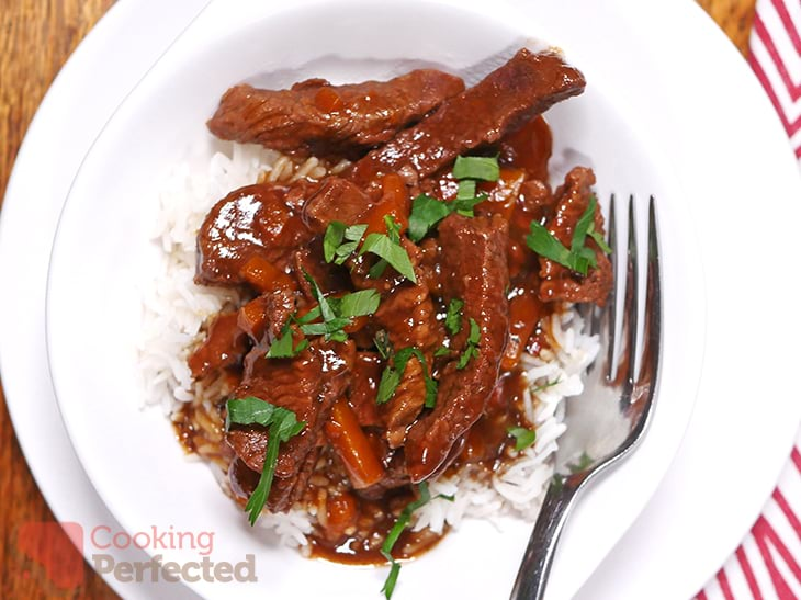 Mongolian Beef served with rice and topped with parsley