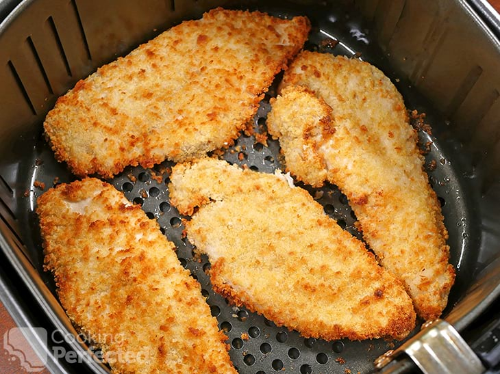 Cooking chicken schnitzels in the air fryer.