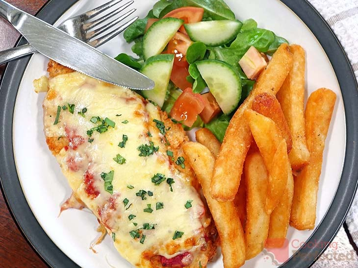 Chicken Parm cooked in the Air Fryer and served with Salad and Fries