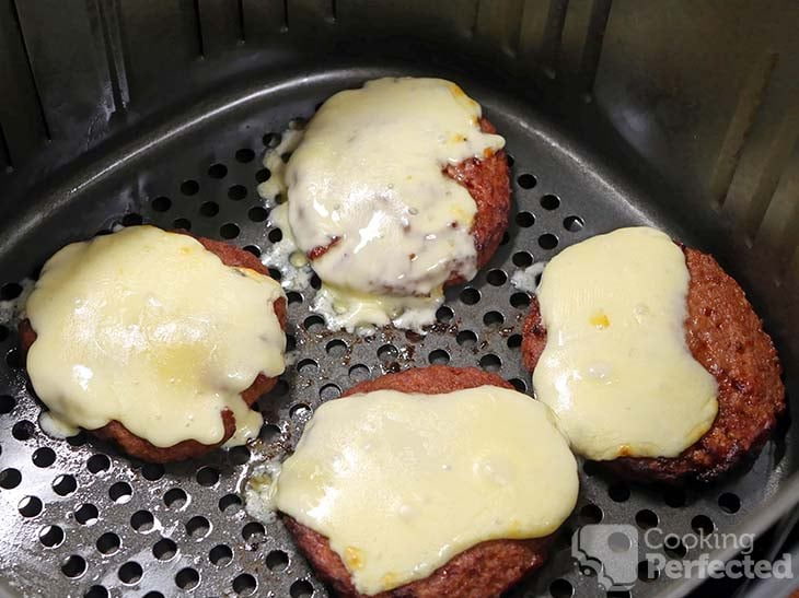 Hamburgers topped with cheddar cheese in the air fryer