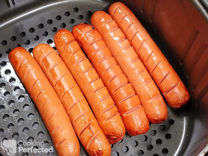 Hot dogs cooking in the air fryer