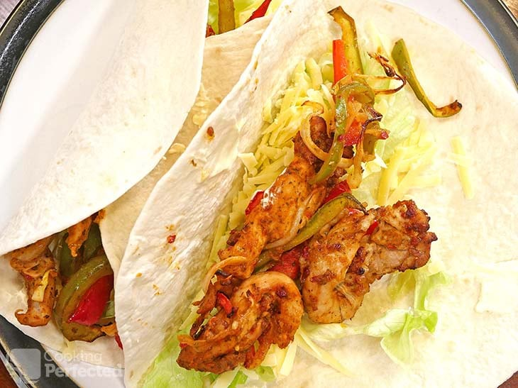 Air-Fried Chicken Fajitas in a tortilla with lettuce, cheddar cheese, and sour cream.